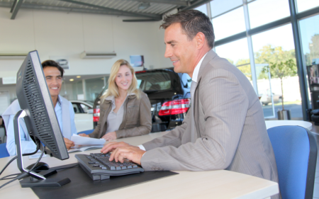 Car Dealer At Computer